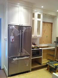 cabinets around refrigerator kitchen design regarding kitchen