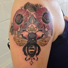 lovely flowers and queen bee tattoos on shoulder for women