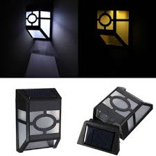 solar wall mounted lights 2 pack solar powered wall mount 2 led light l outdoor garden fence