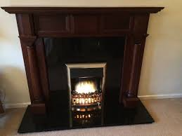 dark wood fire surround granite hearth granite back panel and