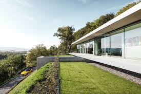 houses built on slopes exploring the world of green roofs and underground homes