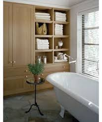 modern powder room with floating vanity mirror and shelving wall
