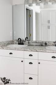 white kitchen cabinets rubbed bronze hardware fixer update cabinet hardware the wood grain cottage