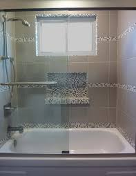 tub shower tile surround with glass mosaic niche nestology tub shower combo design ideas pictures remodel and decor