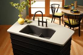 elkay antique steel w dark granite sink and light coutertop