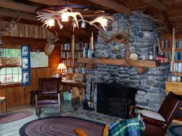 stupendous rustic cabin living room with stone wood burning