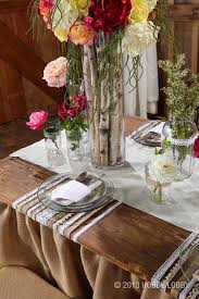 small touches to your tables such as these wooden sticks in a