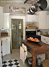 Farmhouse Style Kitchen Islands by Rustic Cabinet Door Complete With Rusted Corrugated Steel Wrapped