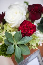 succulent red rose and white hydrangea centerpiece