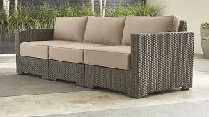 ventura umber sectional with tan outdoor cushions crate and barrel