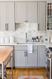 small kitchen gray cabinets kristin corrigan s home is the definition of blissful