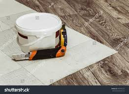 Tools For Laying Laminate Flooring Tool Container Glue Laying Linoleum Flooring Stock Photo 449701222