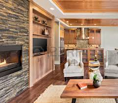 interior of luxury homes living room interior with hardwood floors and fireplace in new