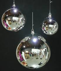 large silver ornaments display seasonals