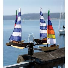 solar and wind powered sailboat spinner with led beacon light