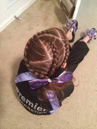 triple dutch braids with a zig zag part gymnastics hairstyles