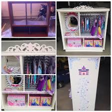 old entertainment center repurposed into a little girls dress up