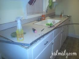 How To Redo Your Kitchen Cabinets by Using Contact Paper To Cover And Redo Countertops