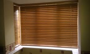 new zealand window blinds can be adjusted by rotating them from an