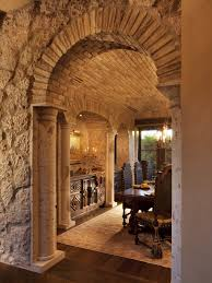 this stone archway provides a memorable entrance into this italian