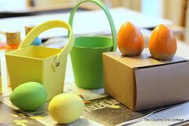 paper mache easter baskets easter basket painted paper mache basket and eggs decoart inc