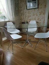 dwell stellar dining table and 4 eiffel chairs in smiths wood