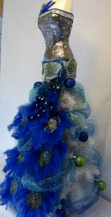 mannequin christmas tree with a peacock theme seams and scissors