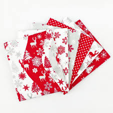 our new range of christmas fabric fat quarters at the craft cotton