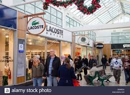 shoppers at lacoste outlet store at mcarthur glen york designer - Designer Outlet Store