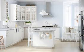 ikea white kitchen island a large white kitchen with a lot of drawers wall cabinets and a