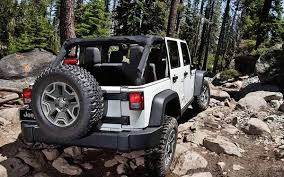 jeep rubicon white rocking out in the 2016 jeep wrangler