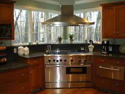 corner range with a chimney hood windows home kitchen