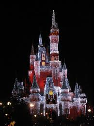 christmas lights on cinderella castle at the magic kingdom in