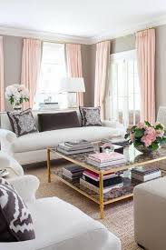 bright living room interior with lovely white sofa set and large