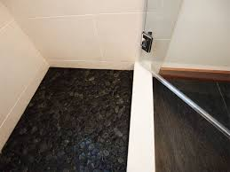 black pebble tile shower floor robinson house decor