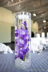unusual lantern and purple candle wedding table centerpiece purple