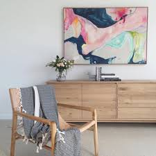 australian home interiors leather and timber smith armchair and large abstract artwork by