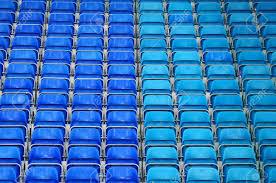empty plastic seats at stadium opendoor sports arena stock photo