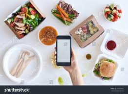 gourmet food delivery holding smartphone mobile cellphone stock photo