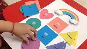toddler doing a rainbow themed color u0026 shape matching activity