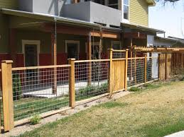 yard fence ideas mix of hog wire fencing and wood panels