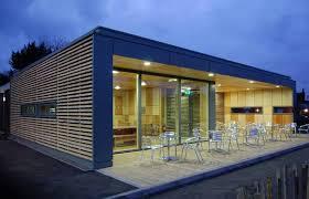 high tech modular demountable café built of straw bale is a