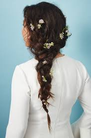 hair flower unique ways to wear wedding hair flowers popsugar beauty