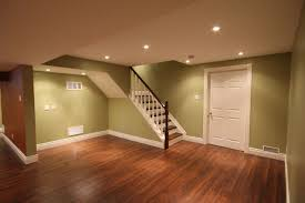 basement white wall with unfinished basement flooring ideas for