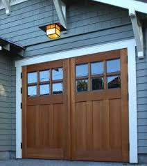 swing out garage doors garage doors 10 styles to boost curb