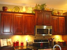 how to decorate above kitchen cabinets shaweetnails decorating above kitchen cabinets tuscan style diy rustic kitchen