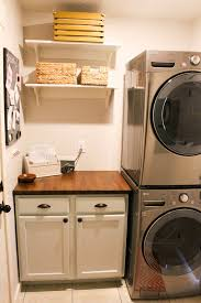 simple laundry room with stackable washer and dryer laundry