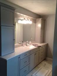 Kraftmaid Bathroom Vanity by Tapered Legs And Slab Doors In Cream Thermofoil Create An