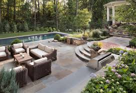 Stone Decks And Patios by Should You Use Flagstone Or Pavers In Your Backyard Patio Design