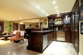 cool basement mini bar area with dark wood cabinets storage and